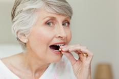 woman taking resveratrol supplement